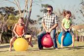 Dad and children playing on the lawn in front of house — Stock Photo