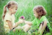 Two happy children  playing near the tree at the day time. — Stock Photo