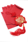 Auspicious Fish Ornament And Red Packets — Stock Photo