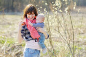 Young woman with little baby  — Stock Photo
