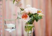 Flowers bouquet and candle as decoration — Stock Photo