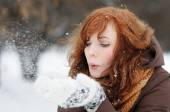 Young beautiful woman having fun in winter — Stock Photo