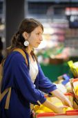 Young woman at supermarket  — Foto Stock