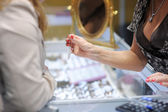 Woman trying wedding rings at a jeweler — Stockfoto
