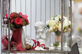 Red and white wedding bouquets and decoration objects — Stock Photo