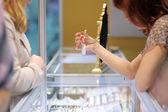 Woman at a jeweler — Foto de Stock