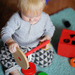 Little baby playing with toy — Stock Photo #58793667