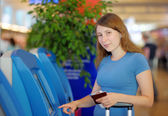 Young woman at the international airport — Stock Photo