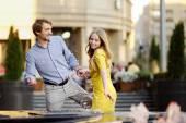 Couple having fun in a city — Stock Photo