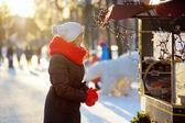 Young beautiful woman at winter city — Stock Photo