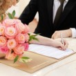 Bride signing marriage license — Stock Photo #63752909