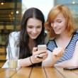 Two young girls using smart phone — Stock Photo #63753013