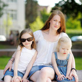 Young mother and her daughters outdoors — Stock Photo