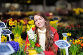 Young woman at Parisian flowers shop — Stok fotoğraf