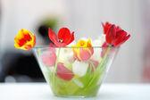 Bright tulip bouquet in glass vase — Stock Photo