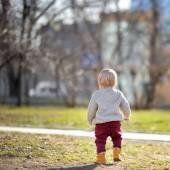 Beautiful toddler boy walking outdoors  — Stock Photo