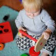 Little baby playing with toy — Stock Photo #68621867