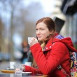 Young woman in a street cafe — Stock Photo #69445755