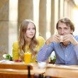 Young dating couple in the outdoor cafe — Stock Photo #69445827