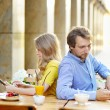 Young dating couple in the outdoor cafe — Stock Photo #69445863