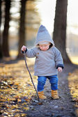 Toddler boy playing outdoors — Stock Photo