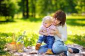 Beautiful young woman and her adorable little son — Stock Photo