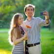 Young couple taking a selfie — Stock Photo #78375092