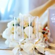 Two glasses and wedding flowers — Stock Photo #78622346