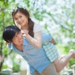Young man giving a piggy back to his girlfriend — Stock Photo #65025489