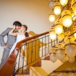 Beautiful asian young bride and groom kissing — Stock Photo #65025861