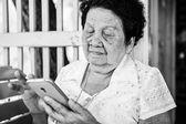 Senior asian woman  with smart phone — Stockfoto