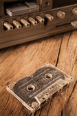 Old cassette tapes and cassette player — Stock Photo