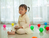 Portrait of little asian girl in home — Stock Photo