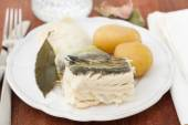 Boiled cod fish with potato on plate — Stock Photo