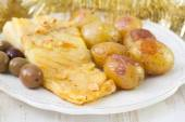 Cod fish with potato and olives — Stock Photo