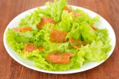 Salad with salted salmon on plate — ストック写真