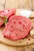 Raw meat with black pepper, garlic and salt — Stock Photo