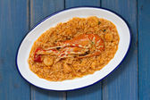 Rice with seafood on white dish — Stockfoto