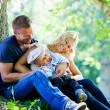 Young family in park — Stock Photo #52584687