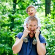 Father in park with son — Stock Photo #52584715