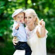 Mother in park with son — Stock Photo #52584719