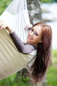 Woman relaxing in hammock — Stock Photo