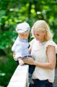 Mother in park with son — Stock Photo