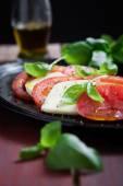 Tomato and mozzarella salad — Stock Photo