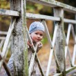 Girl on wooden bridge outdoors — Stock Photo #57977977