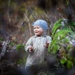 Little girl smiling in autumn forest — Stock Photo #57977999