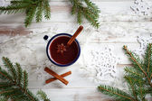 Mulled wine on wooden background — Stock Photo
