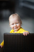Little girl sitting in chair — Stock Photo