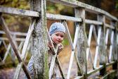 Girl on wooden bridge outdoors — Stock Photo