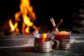 Wine with cinnamon sticks — Stock Photo